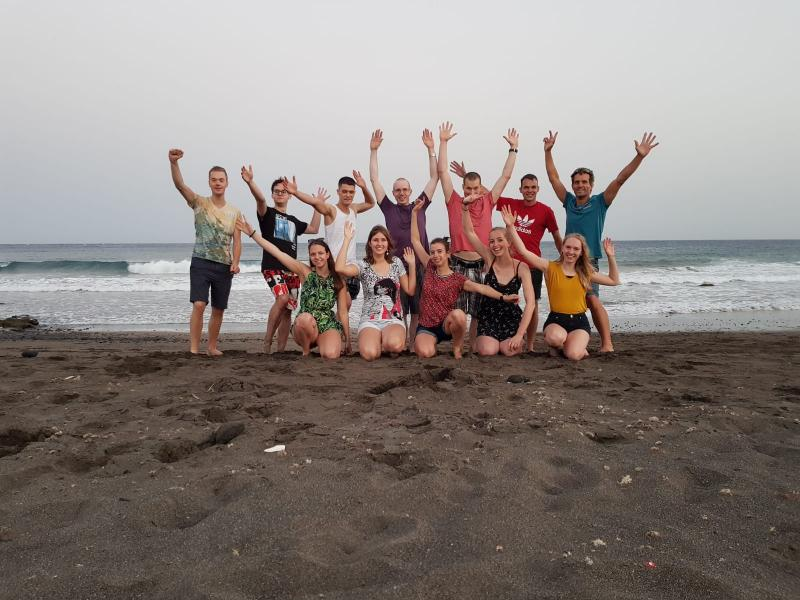 Groepsfoto op het strand